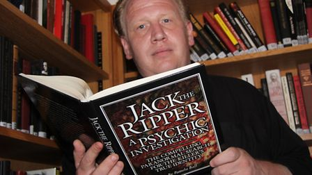 Stefan Dickers, Bishopsgate Institute archivist, with collection of 300 Jack the Ripper books