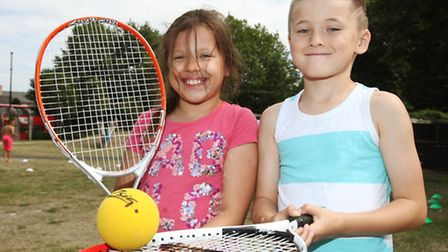 Sibligns Olivia,eight, and Luke Eels, seven, plays tennis at Mile End Children's Pavillion.