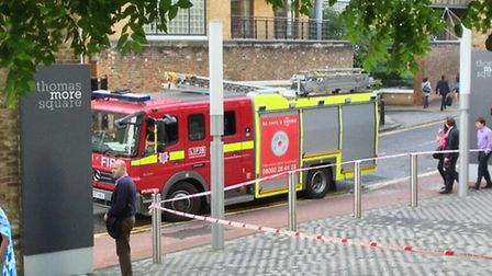 Firefighters at Thomas More Square in Wapping, where they rescued the two window cleaners. Credit: @