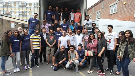 Mohammed Ali and his army of volunteers outside the shipping container he has hired to take the food