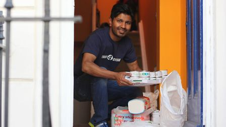 Mohammed Ali prepares food which is to be taken to Syria next month