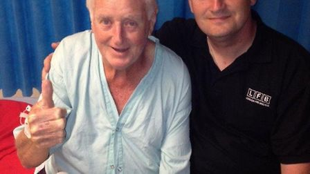 Clinton Walsh is pictured with John Lawrence who suffered a heart attack