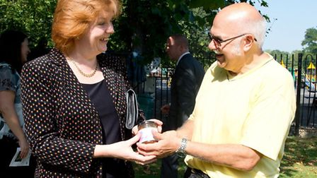 City of London Mayoress Clare Gifford is given relish from tomato grown by Ron Innell at West Ham Pa