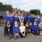 """Students from Richard Alibon Primary School with the """"crashed"""" hot air balloon in their playground."""