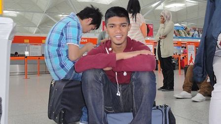 Ajmol Alom, 16, at Belfast airport following a visit to Northern Ireland with school
