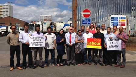 Labour councillors demonstrate against the scrapping of plans for 149 new council homes at Watts Gro