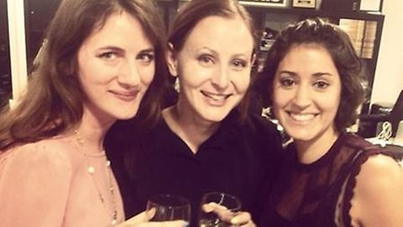 Lauren Pears (centre) celebrates being given planning permission for the cat cafe, in Bethnal Green