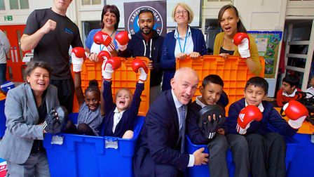 Boxing champ Barry McGuigan meets pupils at Chisenhale Primary to promote healthier lifestyle among