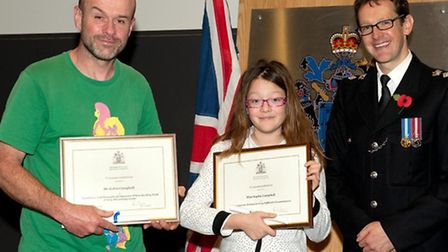 Robin Campbell (L) and his daughter Sophie with Newham borough commander Rob Jones