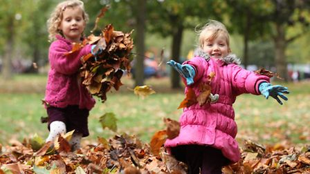 Amelie Casuell, left, and Sienna Dunne enjoy a day out at the Big Leaf Pile event in West Ham Park.