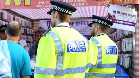 Police question market traders on Whitechapel High Street