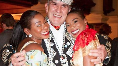 Pearly King grapples with Spitalfields characters Tayo & Abby Abimbola [Picture: Jeremy Freedman]