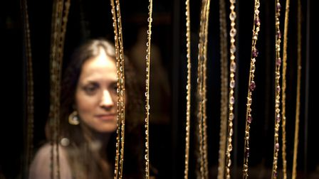 Museum of London'sElpie Psalti looks at bejeweled necklaces and chains [Picture: David Parry]