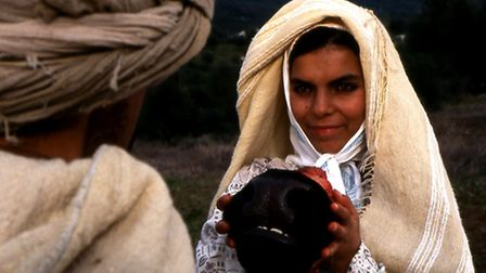 A little girl asks a cattle herder for a cow's mouth for a religious sacrifice... scene from one of