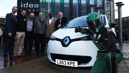 Electric vehicle enthusiast Robert Llewellyn,centre, joins members from Poplar HARCA and E-Car at th