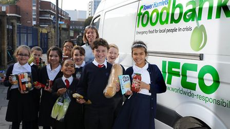 Karin Honeyset from Tower Hamlets Foodbank with Pupils from Our Lady's Catholic School who have coll