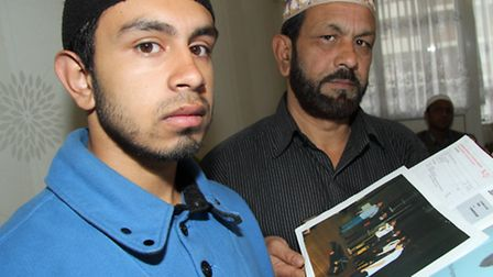 Sultan's brother Thanbir and their father Kabir with the book of his life's achievements