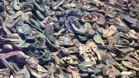 A display of shoes belonging to children who died at the camp