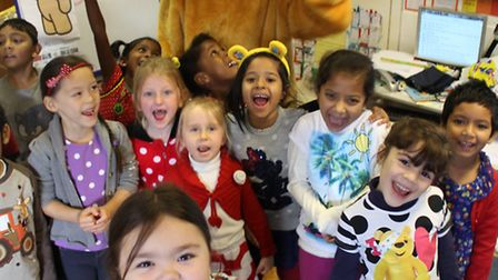 Delighted pupils with Pudsey Bear