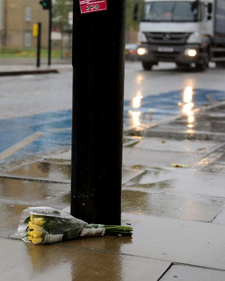 Flowers at the spot where Brian Holt died in Mile End Road