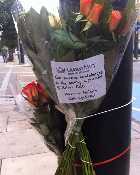 Flowers laid where Brian Holt died on November 5