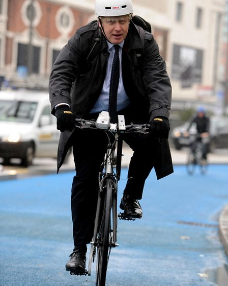 London Mayor Boris Johnson arrives on a bike to the launch of the cycle super highway in Stratford