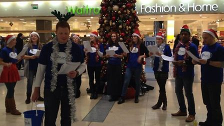 Carol singers from Mind perform at Canary Wharf
