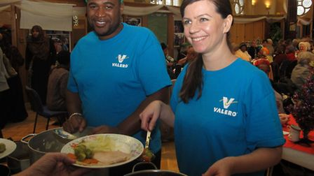 Texaco volunteer Rebecca May helping out at Poplar luncheon club
