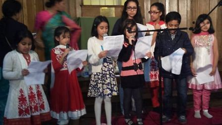 Young children joined in the prayers for victims in Bangladesh