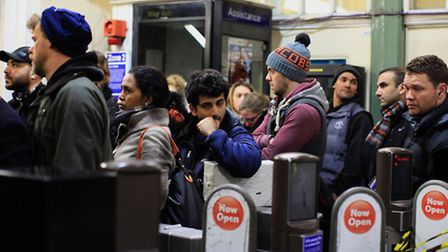 Commuters queue at 7pm in Whitechapel Station on day one of the London's tube strike