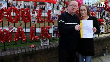 Gerald, 62 and Eileen, 58 Hamilton hold a letter from Tower Hamlets Homes requsting them to remove b