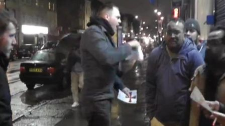 Britain First member hands out leaflets in Brick Lane
