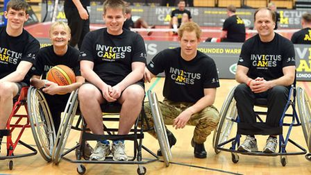 Prince Harry with the wheelchair Basketball teams at the Copper Box in Queen Elizabeth Olympic Park