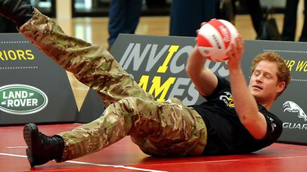 Prince Harry plays volleyball with the injured ex-servicemen