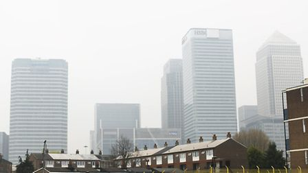 Canary Wharf is surrounded by smog and haze as London hits level nine on air pollution today.