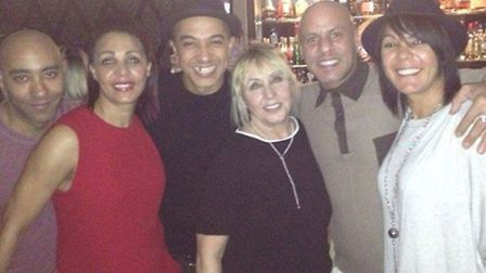 John's brother Carlos (extreme left) with sister Samantha, musician brother Jade from Damage boy ban