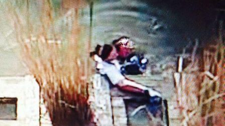 A still from Pc Plant's headcam showing Pc Moon helping the woman to safety