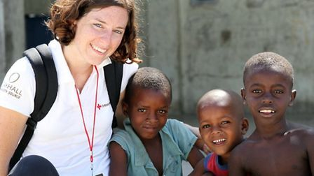 Mandy with children in Haiti... before being struck with Malaria