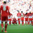 Leyton Orient players look dejected after teammate Mathieu Baudry's penalty is saved in the League O