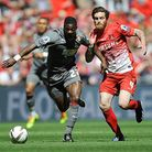 Leyton Orient's Romain Vincelot battles for the ball with Rotherham United's Kieran Agard. The forme