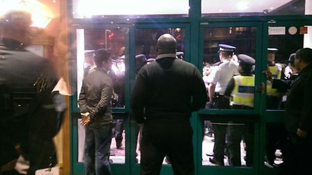 Police block the entrance to the Troxy theatre