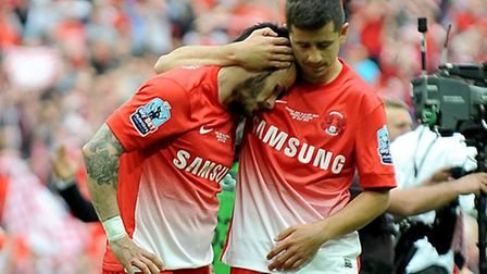 Leyton Orient's Chris Dagnall (left) is comforted by teammate Lloyd James after his saved penalty pr