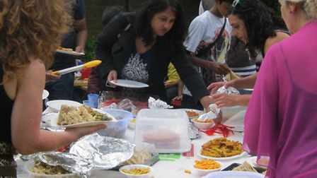 Tucking in... neighbours at the Big Lunch at Bethnal Green's Teesdale estate