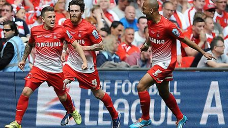 Leyton Orient's Dean Cox (left) celebrates scoring his team's second goal against Rotherham with Rom