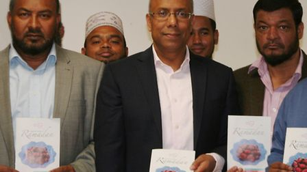 Mayor of Tower Hamlets, Lutfur Rahman (centre) at the booklet's launch