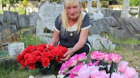 Kate Webber's daughter Cathy Carter, 69, at her grave in Manor Park cemetery