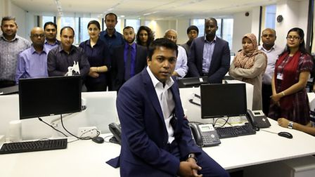 Managing Director of Zamir Telecom Limited Naufal Zamir with staff in the office.