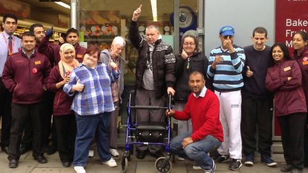 Supermarket staff meet service users and employees from Phoenix café in Bell Lane, chosen as their '