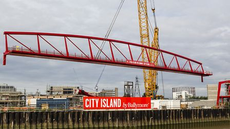 Biggest crane in Britain lowers the Leamouth footbridge across the Lea to link Ballymore's Blackwall