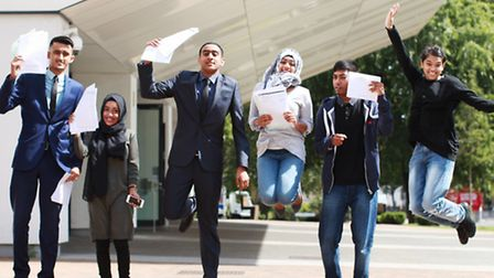 Jumping for joy... A-level pupils at Paul's Way Trust school